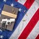 Gun on Holy Bible with American Flag - PhotoDune Item for Sale
