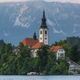 Bled Lake Church on Island with Julian Alps in Background at Alpine Landscape in Slovenia - PhotoDune Item for Sale