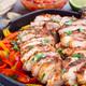 Chicken Fajitas in a pan, served with salsa Asada, sour cream, avocado and tortillas - PhotoDune Item for Sale