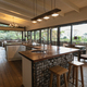 Interior of open plan kitchen diner and living room of comfortable home, with windows to terrace - PhotoDune Item for Sale