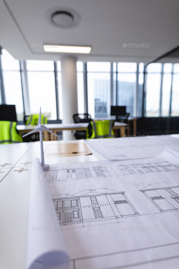 Interior of empty modern office with desks and drawings - Stock Photo - Images