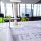 Interior of empty modern office with desks and drawings - PhotoDune Item for Sale