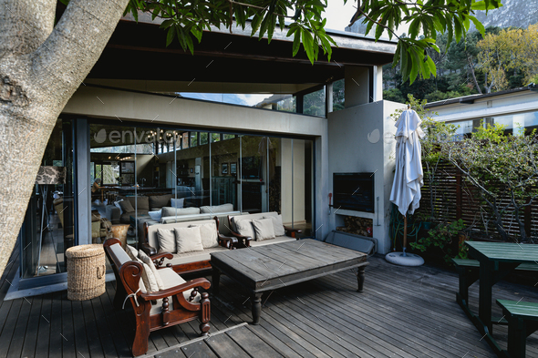 View of nice luxury terrace and garden of comfortable modern home - Stock Photo - Images