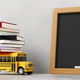 Back to school. Empty blackboard, yellow bus toy and books - PhotoDune Item for Sale