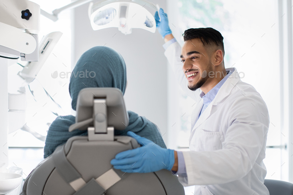 Young Arab Dentist Doctor Having Check Up With Islamic Female Patient - Stock Photo - Images
