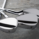 Chrome Golf Club Wedge Iron Set On Rock Surface. - PhotoDune Item for Sale