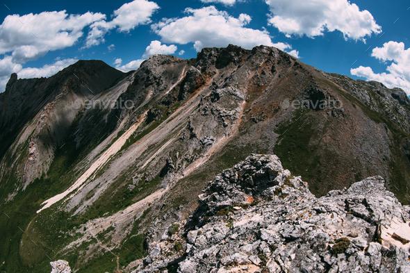 High altitude mountain landscape under blue sky - Stock Photo - Images