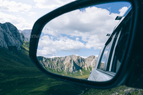 Driving off road car in high altitude forest mountains - Stock Photo - Images