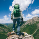Successful woman hiker with camera on high altitude mountain top - PhotoDune Item for Sale