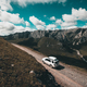 Driving off road car on high altitude mountain top - PhotoDune Item for Sale