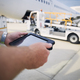 Member of ground staff using tablet against plane at airport - PhotoDune Item for Sale