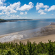Panoramic shot of LLansteffan beach with clear blue water in southern Wales - PhotoDune Item for Sale