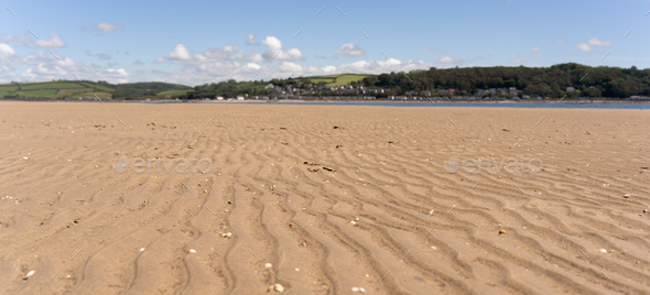 Panoramic image of sand in LLansteffan beach in southern Wales - Stock Photo - Images