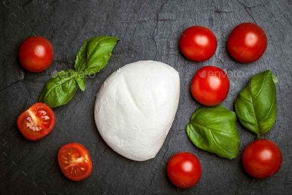 Mozzarella, tomato and basil. - Stock Photo - Images