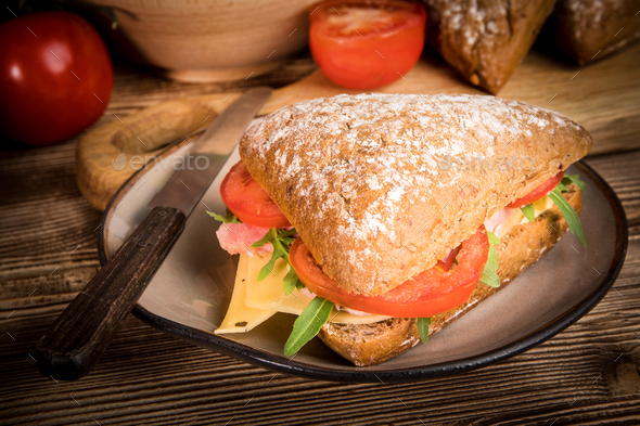 Triangular sandwich with cheese, ham and tomato. - Stock Photo - Images
