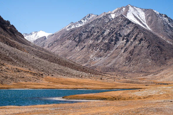 Landscape image of Pangong lake with mountains view and blue sky background - Stock Photo - Images