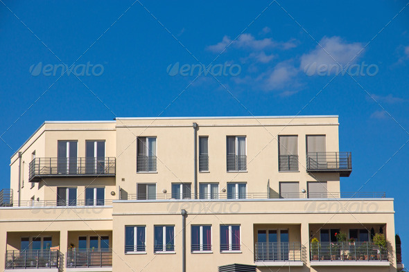 Beautiful yellow apartment house - Stock Photo - Images