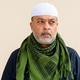 Portrait of handsome bearded muslim man against plain wall - PhotoDune Item for Sale