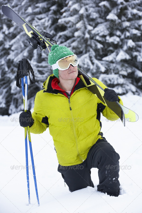 Young Man On Ski Holiday In Mountains - Stock Photo - Images