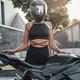 Woman wearing helmet and sportswear with black motorbike - PhotoDune Item for Sale