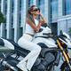 Woman dressed in stylish clothing sitting on motorbike - PhotoDune Item for Sale