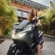 Young sportswoman sitting on bike around modern mansion - PhotoDune Item for Sale