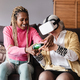 Senior and young girl playing virtual reality video games at home - Focus on african woman face - PhotoDune Item for Sale