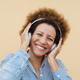African senior woman listening music with headphones outdoors in the city - Technology and lifestyle - PhotoDune Item for Sale