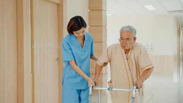 Young Asian woman nurse caregiver assistance encourage take care her senior patient  explain. - Stock Photo - Images