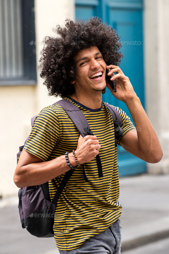 happy young man talking with mobile phone outdoors - Stock Photo - Images