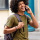happy young man talking with mobile phone outdoors - PhotoDune Item for Sale
