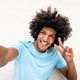 Close up happy young man with afro hair taking selfie by isolated white background - PhotoDune Item for Sale