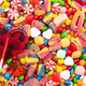 Colorful lollipops and different colored round candy. - PhotoDune Item for Sale