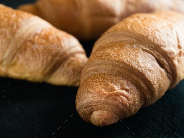 Fresh croissants on black slate background - Stock Photo - Images