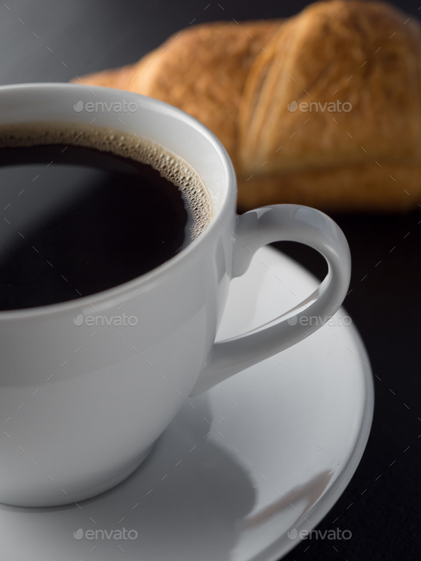 Cup of coffe and croissants - Stock Photo - Images
