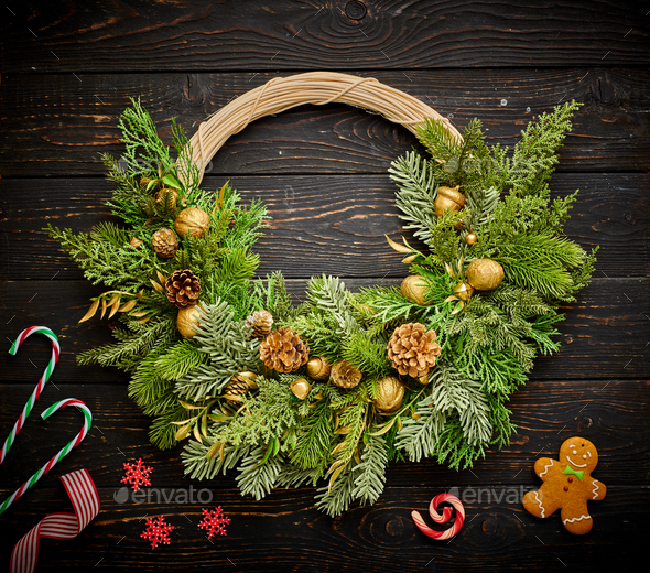 Christmas wreath on dark wooden background - Stock Photo - Images