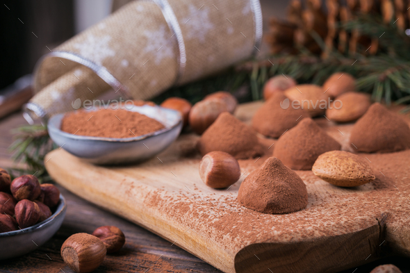 Homemade chocolate truffles, nuts, almonds and cocoa powder - Stock Photo - Images