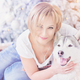 Beautiful blonde woman sits with husky dog near christmas tree. - PhotoDune Item for Sale