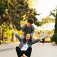 Young Couple practicing skateboarding outdoors - PhotoDune Item for Sale
