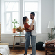 Mixed race couple dancing at home - PhotoDune Item for Sale