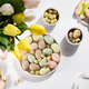 Easter color eggs in a Bowl with tulips, flat lay - PhotoDune Item for Sale