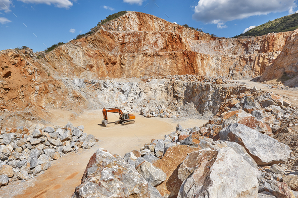 Heavy excavator on a quarry. Excavation machinery. Earthmover - Stock Photo - Images
