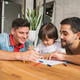 Gay couple having fun with their son at home. - PhotoDune Item for Sale