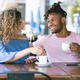 Young couple drinking coffee at a coffee shop. - PhotoDune Item for Sale
