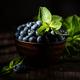 Freshly picked blueberries in wooden bowl - PhotoDune Item for Sale