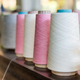 Receding line of alternating reels of pink and white cashmere - PhotoDune Item for Sale