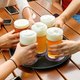 Friends with beer glasses at table - PhotoDune Item for Sale