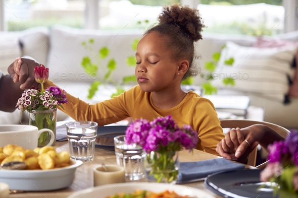 Multi Generation Family Holding Hands Around Table At Home Saying Grace Before Eating Meal Together - Stock Photo - Images
