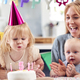Grandmother With Mother And Grandchildren Celebrating With Fifth Birthday Party At Home - PhotoDune Item for Sale