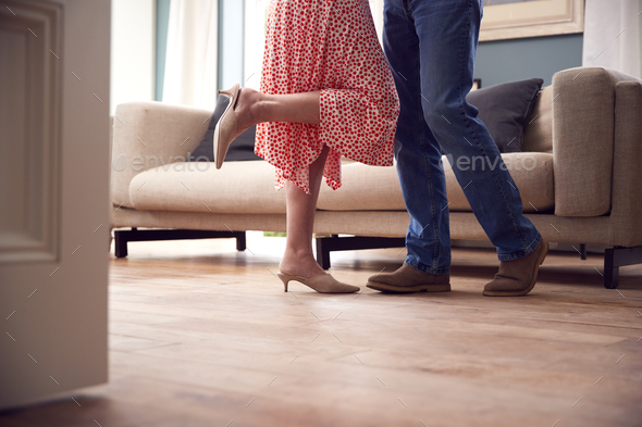 Close Up On Legs As Romantic Senior Retired Couple Dancing In Lounge At Home Together - Stock Photo - Images